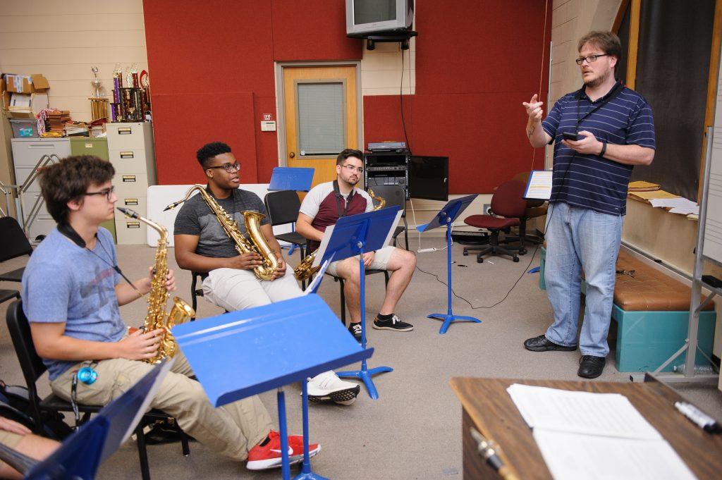 jazz quartet being instructed in a practice studio